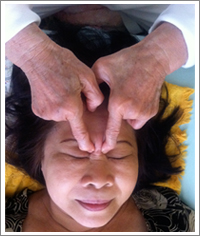 Pressure point massage for tired eyes